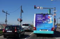 Dolmen – reklaam bussi tagaküljel
