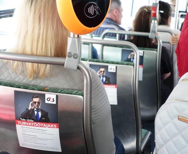 G4S – reklaam bussis, istmete seljatugedel